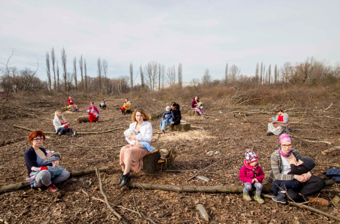 Mothers sitting on tree stumps (link to story by Rachel Fritts)