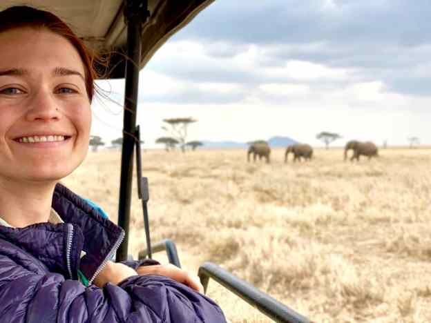 Photo of Rachel Fritts with elephants